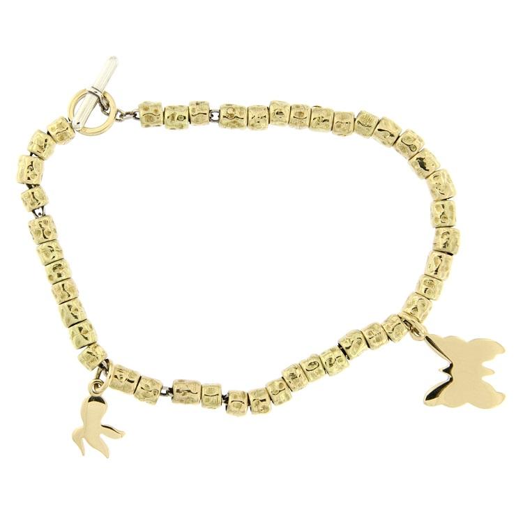 nuova collezione d36e5 4f1ca Bracciale Dodo con ciondoli in oro giallo e argento